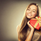 Beauty happy girl with Valentine gift box